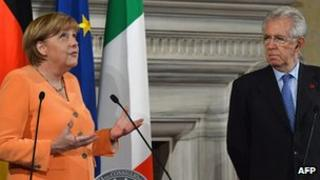 German Chancellor Angela Merkel and Italian PM Mario Monti, 4 July 12