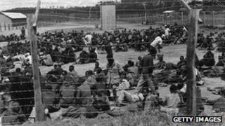 Suspected Mau Mau activists in a prison camp, Nairobi, 1953