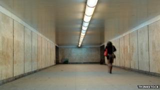 Woman walking with handbag in a tunnel