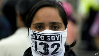A member of the #YoSoy132 movement takes part in a protest outside the Federal Electoral Institute on 10 July