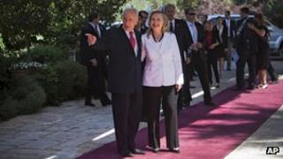 Israel's President Shimon Peres, left, welcomes US Secretary of State Hillary Rodham Clinton, prior to their meeting at the president's residence in Jerusalem