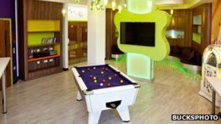 A recreation room with pool table