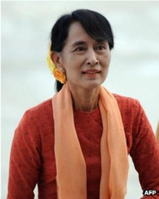 Burma's opposition leader Aung San Suu Kyi arrives at the lower house of parliament in Nay Pyi Taw in this 11 July, 2012 file photo