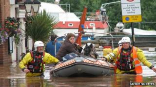 Claire Bunn and her dogs transported fro the flooded pub