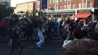 Torchbearer runs with the flame