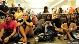 Penn State students watch the NCAA des liver sanctions against the university's celebrated football programme State College, Pennsylvania 23 July 2012