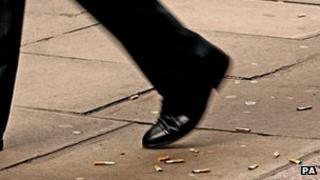 Man walking and discarded cigarette ends