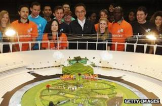 Danny Boyle poses with London 2012 Olympic Games volunteers