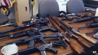 This undated handout photo provided by the Prince George's Maryland County Police shows weapons found in the possession of a suspect who they say was plotting a shooting in his workplace.
