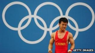 China's Wu Jingbiao reacts while competing in the Men's 56kg Weightlifting on Day 2 of the London 2012 Olympic Games at ExCeL, 29 July 2012
