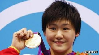 China's Ye Shiwen poses with her gold medal for the women's 400m individual medley at the London 2012 Olympic Games at the Aquatics Centre 28 July, 2012