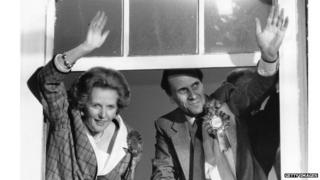 Margaret Thatcher and Norman Tebbit waving from inside Smith Square after the 1987 election