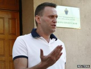 Alexei Navalny speaks to reporters outside the offices of the Investigative Committee in Moscow, 31 July