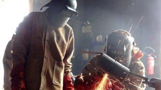 Men welding