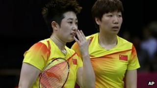 China's Yu Yang, left, and Wang Xiaoli talk while playing in a women's doubles badminton match at the 2012 Summer Olympics in London, 31 July 2012