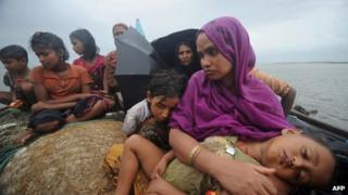 Rohingya Muslims, trying to cross the Naf river into Bangladesh to escape sectarian violence in Burma (12 July)