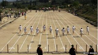 Hoplites running in 2008 recreation of ancient race