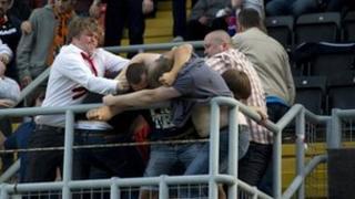 Fans fighting at Tannadice