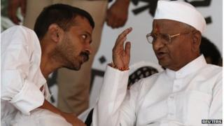lVeteran Indian social activist Anna Hazare (R) speaks to Arvind Kejriwal, a member of his team during their hunger strike in New Delhi August 2, 2012. A