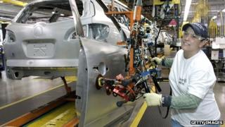 A worker builds an SUV at a General Motors plant in Lansing, Michigan