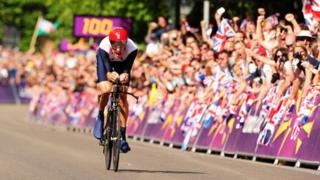 Bradley Wiggins races towards the finish line at Hampton Court Palace in the cycling time trial