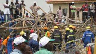 Rescue workers at the collapsed building