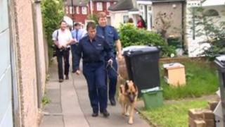 A police dog is taken to the home of Christine Sharp