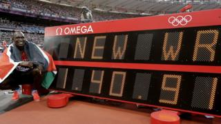 Rudisha next to his new world record time