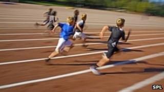 Children running on an athletics track