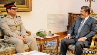 President Mursi, right, with new defence minister Abdul Fattah al-Sissi. 13 Aug 2012