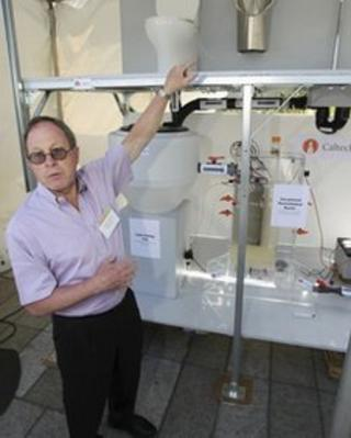 Prof Michael Hoffman with winning design at Gates Foundation's Reinvent the Toilet fair