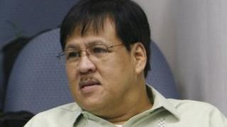 Philippines Interior Minister Jesse Robredo attends an inquiry at Senate headquarters in Manila in this September 30, 2010 file photo