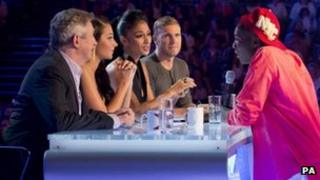 X Factor judges with contestant Sheyi
