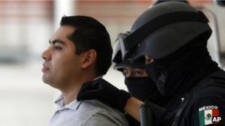 Federal police parade suspect Bogard Felipe Lugo de Leon before the media