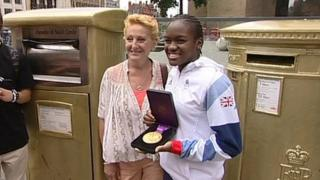 Nicola Adams and two gold postboxes