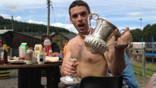 A player with the broken cup