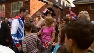 Crowd welcomes Kristian Thomas homes