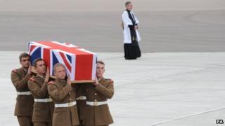 The body of Guardsman Jamie Shadrake arrives back at RAF Brize Norton
