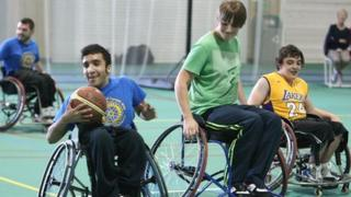 Young people take part in wheelchair basketball