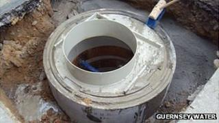 Manhole chamber being repaired
