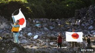 Members of a Japanese nationalist group land on Uotsuri island, part of the disputed islands in the East China Sea, known as the Senkaku isles in Japan and Diaoyu islands in China, in this Kyodo photograph, 19 August 2012