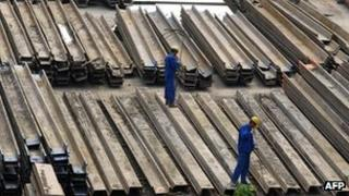 Workers at a steel factory in China