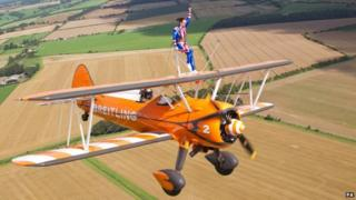 Beth Tweddle wing-walking over Gloucestershire countryside