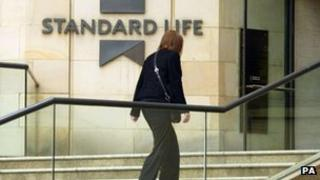 Woman walking into Standard Life building