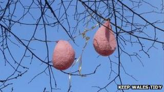 Deflated balloons in a tree
