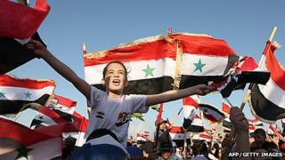 Syrian government supporters in Damascus (file photo)