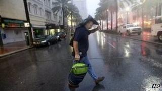 Ronnie Willis makes his way across Canal Street through the wind and rain from Hurricane Isaac in New Orleans 29 August 2012