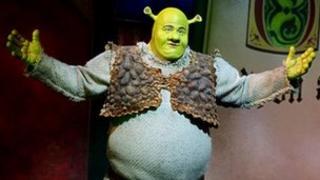 Dean Chisnall in Shrek the Musical. Photo by Tristram Kenton