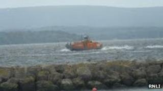 Poole RNLI all-weather lifeboat searching for the family