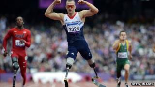 Great Britain's Richard Whitehead (C) wins the men's 200 metres T42 Final